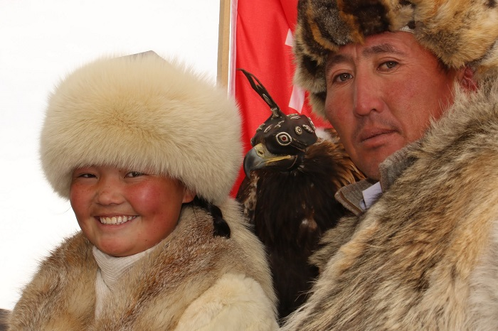 Aisholpan with her father at the Eagle Festival
