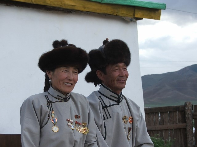 Uuganaa's parents wearing their traditional deels and medals